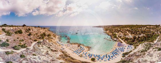 Panorama of the beach. Sea, beach umbrellas.