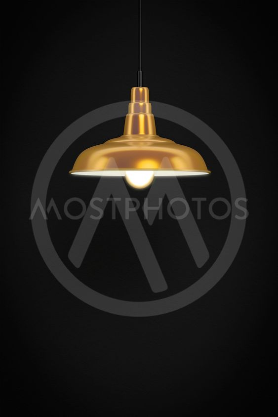 golden lamp in front of a dark wall