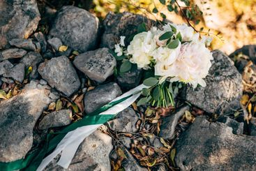 bridal bouquet of white peonies and roses, branches of...