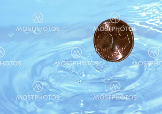 Coin drops in water