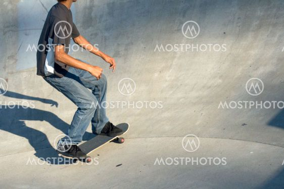Young Male Skateboarder in the pit