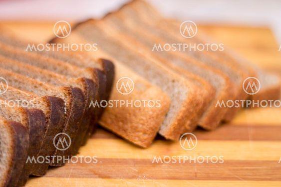 Black rye bread sliced on a wooden board
