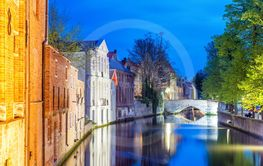Bruges, Belgium. Night view of city canal and medieval...
