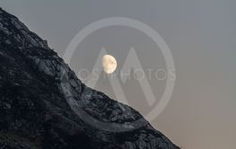 Moon rising over welsh mountainside early evening