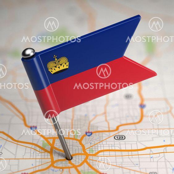 Liechtenstein Small Flag on a Map Background.