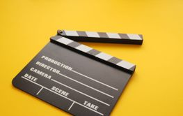 Clapboard on a yellow background