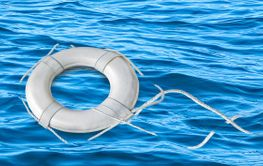 white nautical life preserver on water