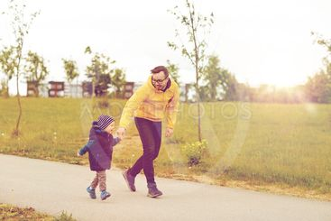 happy father and little son walking outdoors