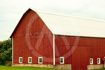 old red barn on a stone foundation