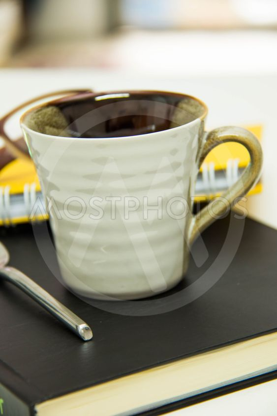 business objects  papers  cups of coffee  glasses