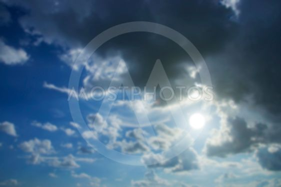 Blur image of blue sky with white could