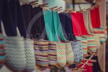 Colorful textile slippers on display