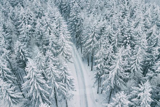 Aerial view of the mountain road in snowy winter