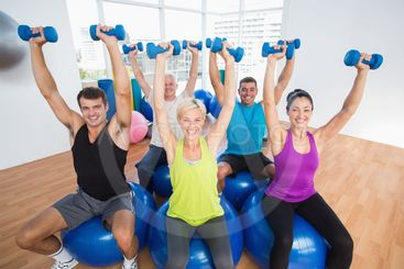 People lifting weights in gym class