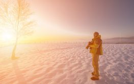 portrait of male photographer on sunset at winter nature