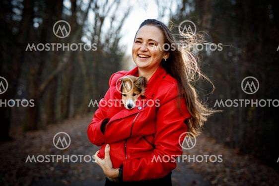 Woman with dog in the forest.