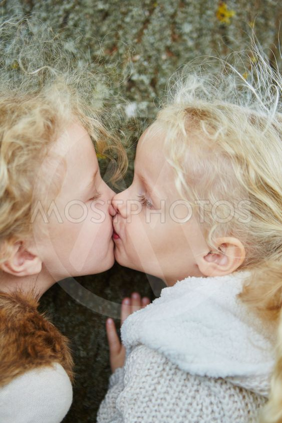 Kiss between two little sisters
