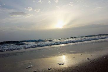beach waves on sunrise