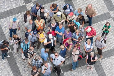 Top view group of unknown tourists waiting at the old...
