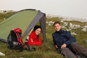 Young people camping in the mountains
