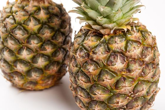 two big pineapples on a white background