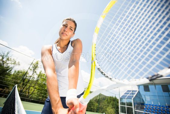 Young woman playing tennis