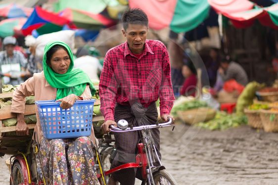 Burmese sellers riding bicycle