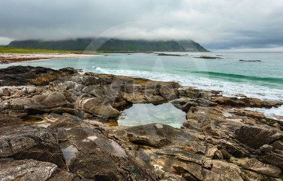 Ramberg beach summer cloudy view (Norway, Lofoten).