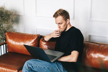 Pensive caucasian man mobile developer programmer writes...