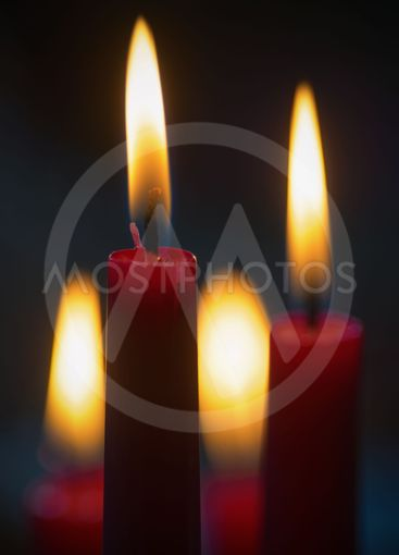 Red candles with dark background