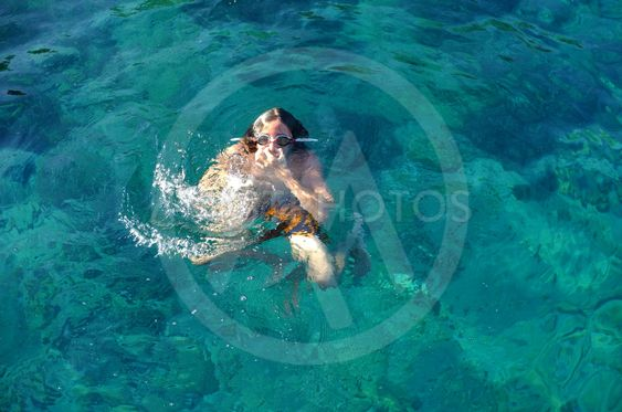 Young teenager playing in the sea