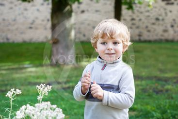 Little cute toddler boy with blond hairs
