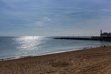 Barcelona beach in winter, with a calm sea.