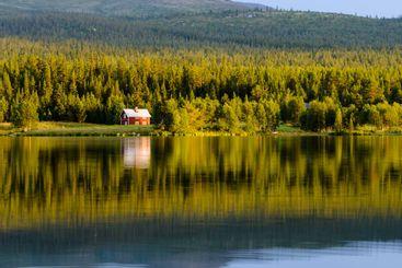 House and trees on lake, Lofsdalen, Härjedalen, Sweden