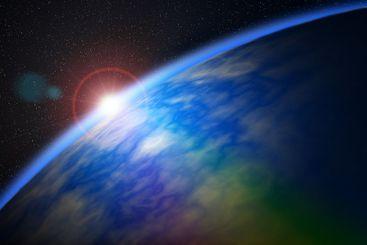 Soluppgång över jordklotet sett från ytter rymden.