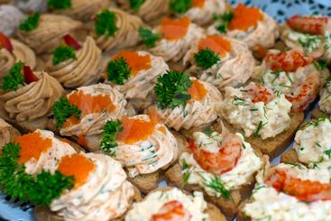 Canapes with caviar and paste