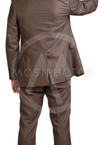 Businessman holding hand up in front of him