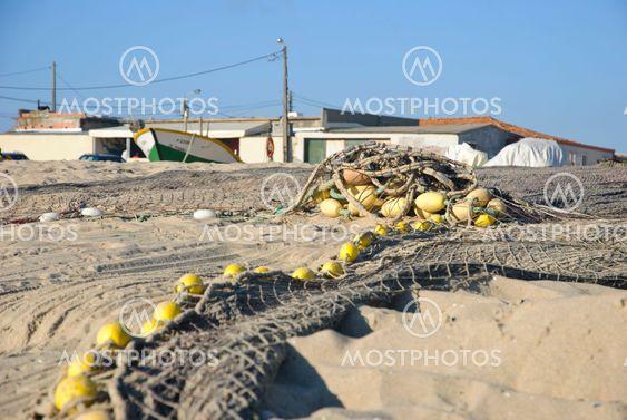Fiskeri net på stranden