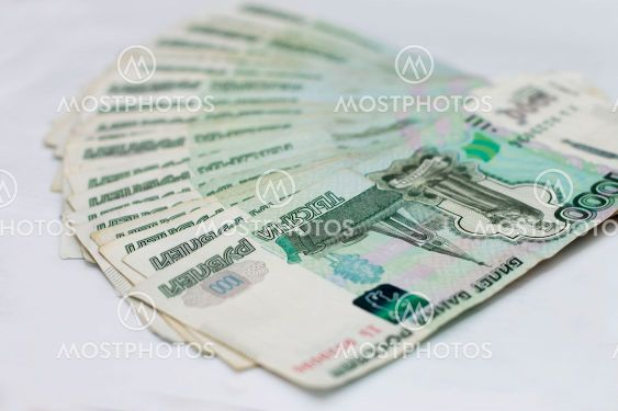 Scattered Russian 1000 rubles banknotes closeup