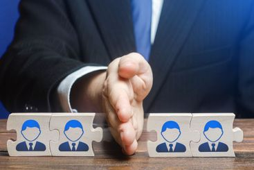 A man divides puzzle team of employees. Team split,...