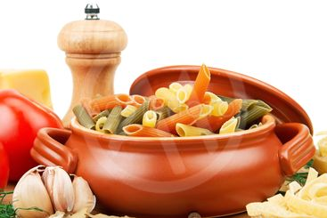 pasta and spices in a ceramic pot