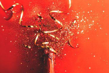 bottle of champagne near confetti