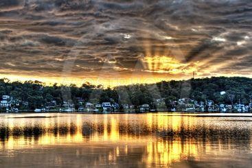 Golden Crepuscular sunrise water reflections.