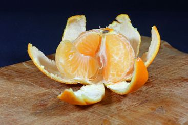 Pieces of mandarin in the remaining peel one piece come...