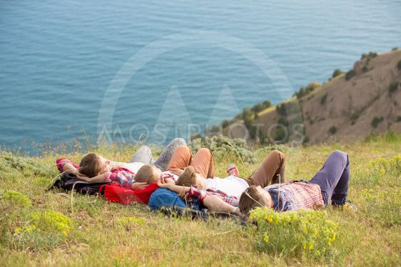 Family resting in mountains