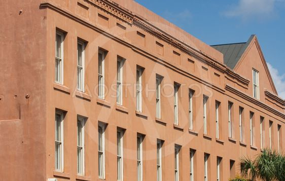 Many Windows in Brown Plaster Building