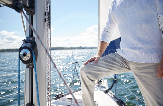close up of senior man on yacht sailing in sea