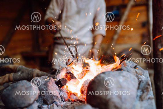 Fire crackling in blacksmith workshop of forging metal....