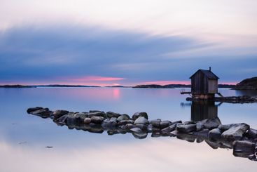 Sunset over building and lake, Brottkärr, Gothenburg,...