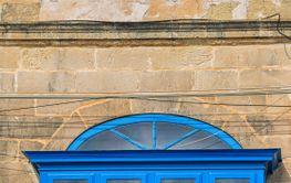 Bright blue balcony, typical for Malta.